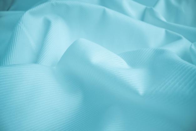 Textura de pano fluindo brilhante no fundo do tiro macro