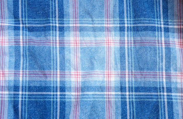 Textura de pano quadriculada. quadrados em têxteis. fundo de tecidos naturais.