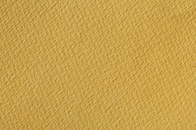 Textura de papel amarelo escuro. foto de alta resolução.