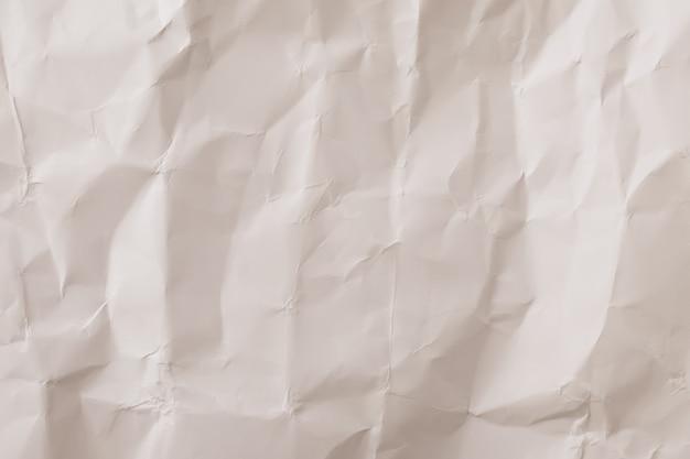 Textura de papel amassado, fundo vintage. papel de parede bege neutro