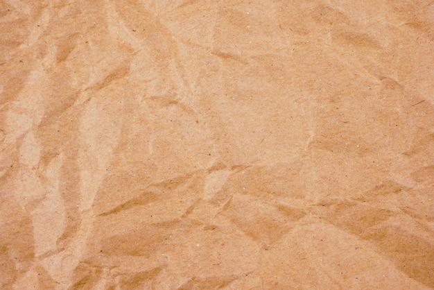 Textura de papel amassado marrom velho de fundo
