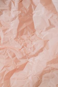 Textura de papel amassado pêssego colorido