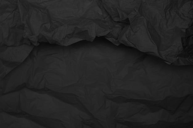 Textura de papel amassado preto, fundo escuro