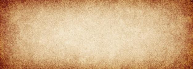 Textura de papel áspero de fundo marrom grunge antigo com vinheta