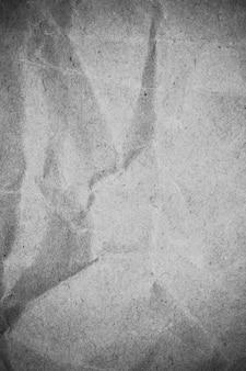 Textura de papel cinza amassado.