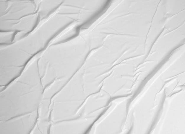 Textura de papel colado branco com efeito grunge de superfície de vincos