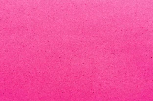 Textura de papel cor-de-rosa para a terra traseira.
