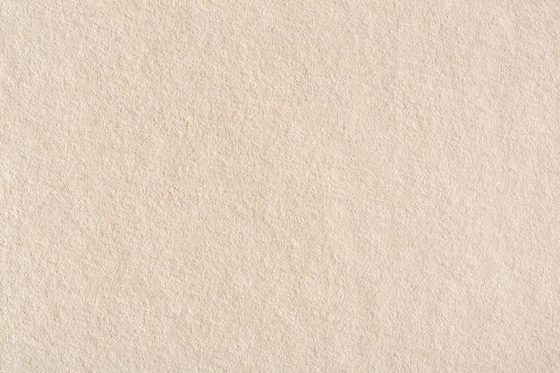 Textura de papel creme marrom claro velha. foto macro de alta resolução.