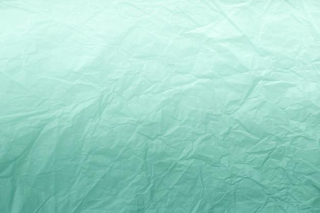 Textura de papel de embrulho verde amassado com gradiente branco