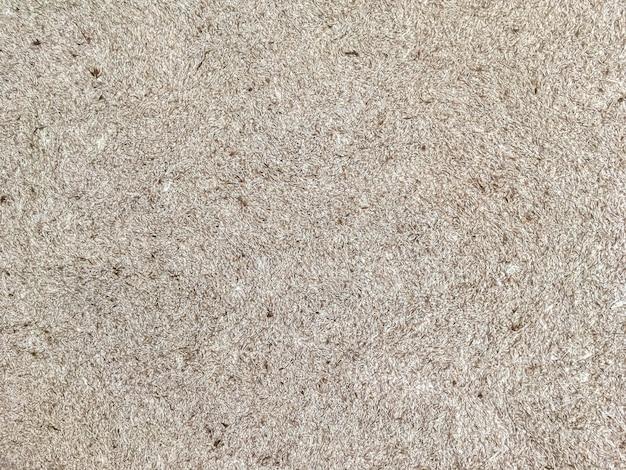 Textura de papel de parede bege com um padrão