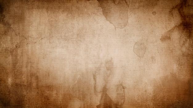 Textura de papel grunge vintage marrom com manchas e listras para design com espaço para texto