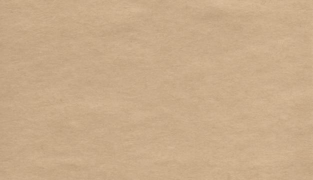 Textura de papel kraft em branco. fundo natural abstrato. superfície áspera castanha. ilustração de papelão.