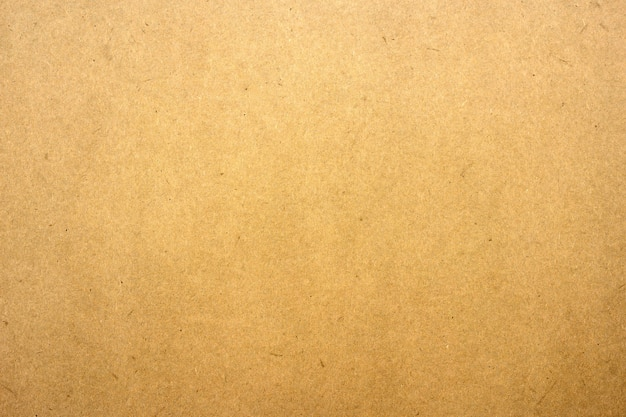 Textura de papel ou papelão marrom para a superfície.