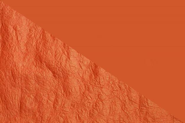 Textura de papel para duas partes na cor laranja. estrutura de papel laranja crepe enrugada.