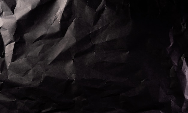 Textura de papel preto amassado.