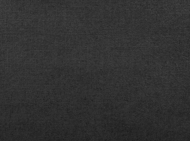 Textura de papel preto. fundo de material escuro feito de papelão.