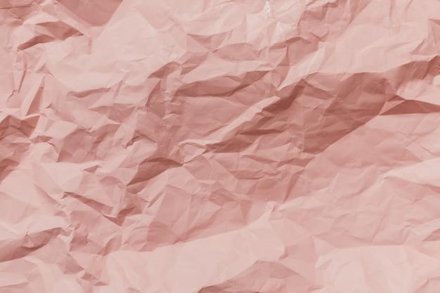 Textura de papel rosa amassado