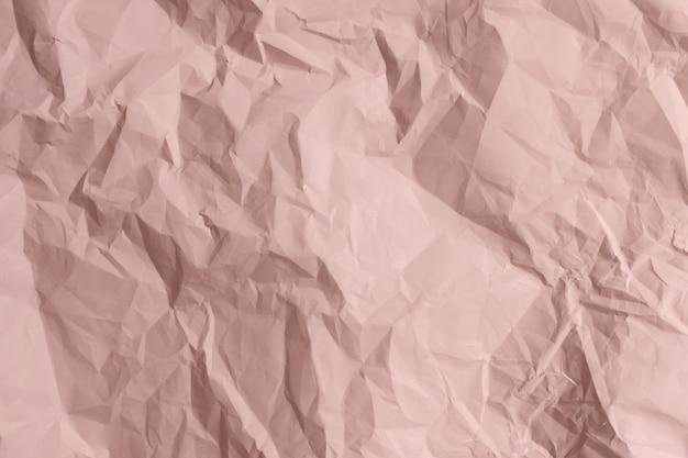 Textura de papel rosa amassado Foto Premium