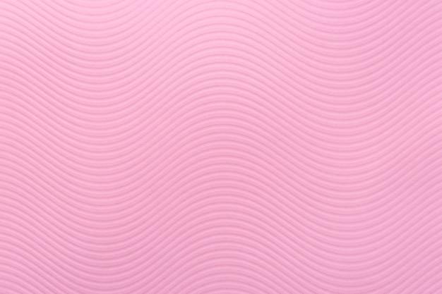 Textura de papel rosa, padrão de arte, ondas suaves, listras, cor delicada, parede áspera, design de relevo de onda curva