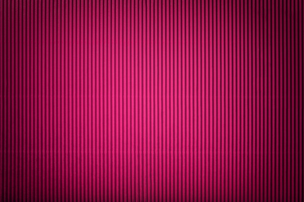 Textura de papel roxo ondulado com vinheta, macro.