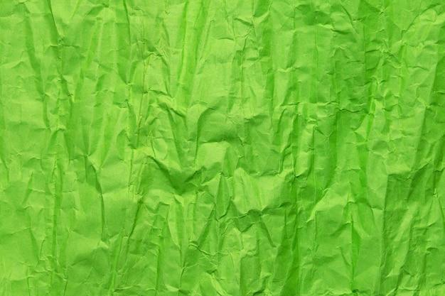 Textura de papel verde amassado, fundo grunge