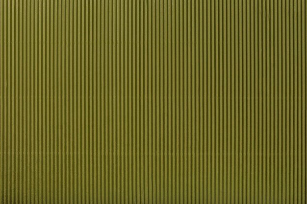 Textura de papel verde escuro ondulado, macro.