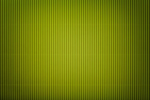 Textura de papel verde ondulado com vinheta, macro.