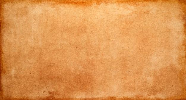 Textura de papel vintage amarelo-acastanhado, fundo abstrato grunge e espaço para texto