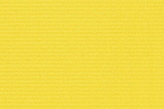 Textura de papelão amarela. fundo de papel artesanal.