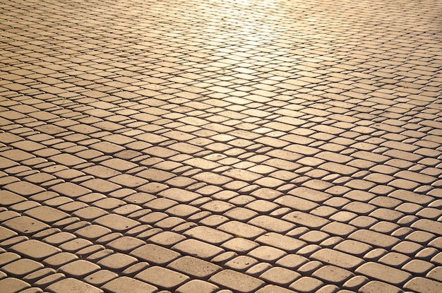 Textura de paralelepípedos, iluminada pela luz solar