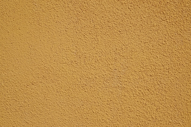 Textura de parede amarela grunge.