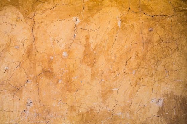 Textura de parede de barro de crack e fundo, construção de material