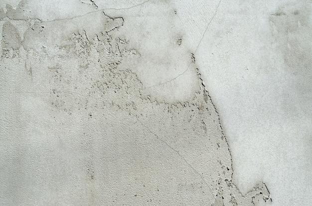 Textura de parede de cimento pintado cinza sujo