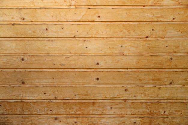 Textura de parede de madeira velha com padrão horizontal marrom claro