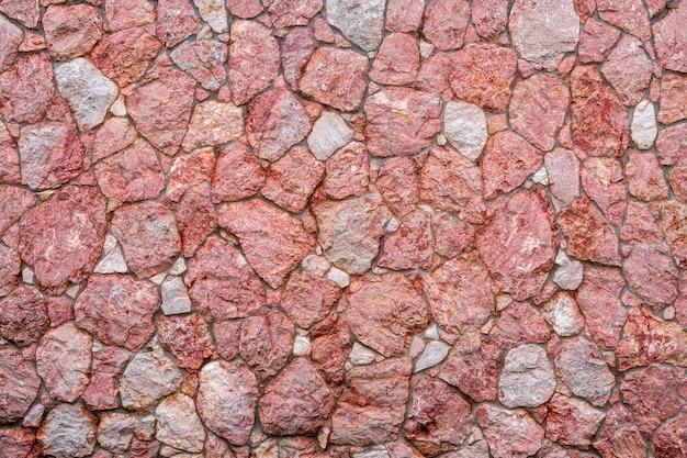 Textura de parede de pedra de mármore roxo e rosa pilha de design de tijolos irregulares