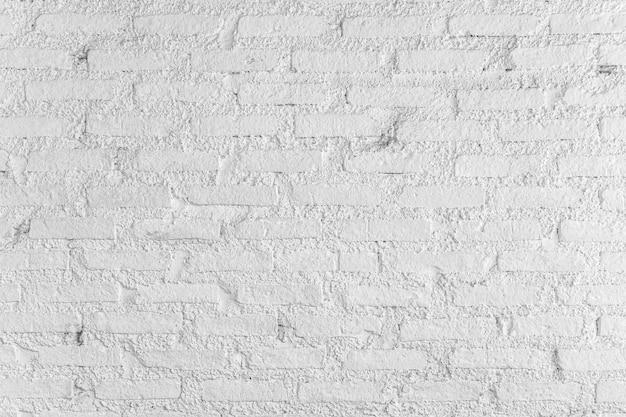 Textura de parede de tijolo branco e fundo