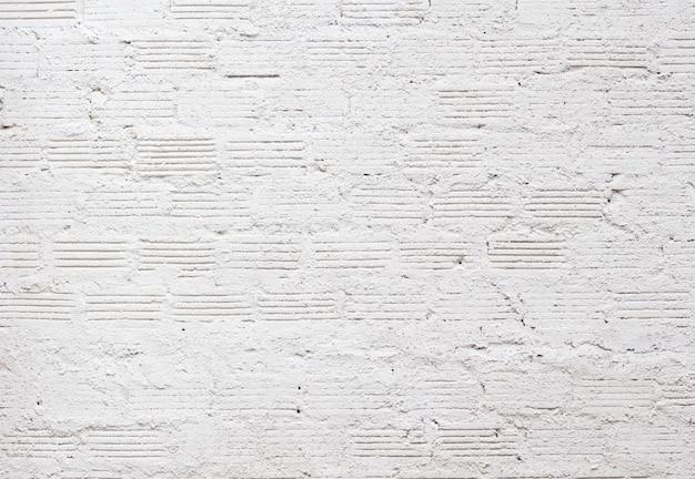 Textura de parede de tijolo branco para o fundo padrão