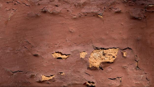 Textura de parede de tijolo de close-up com rachaduras. com espaço de cópia