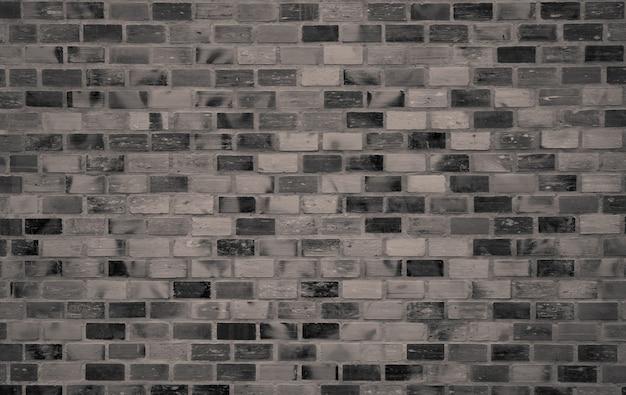 Textura de parede de tijolo escuro. papel de parede antigo padrão vintage. arquitetura interior da construção da parede de tijolo do grunge. textura áspera da parede de tijolo. design de interiores para casa estilo loft. parede preta e cinza