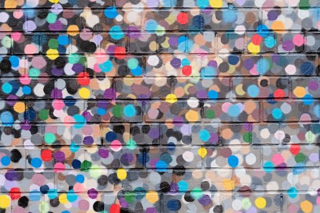 Textura de parede de tijolo moderno pontos coloridos para plano de fundo