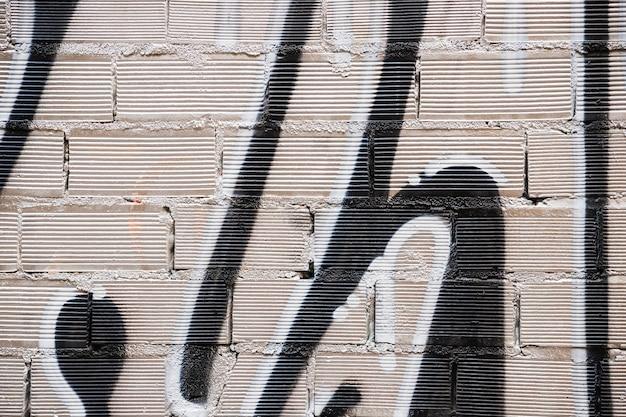 Textura de parede de tijolos com graffiti