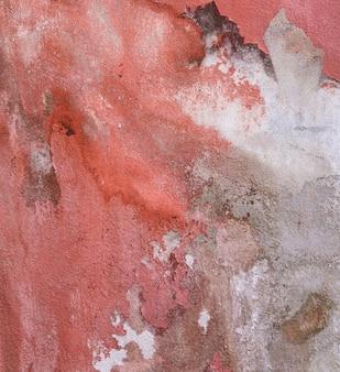 Textura de parede de tinta vermelha resistida descascando