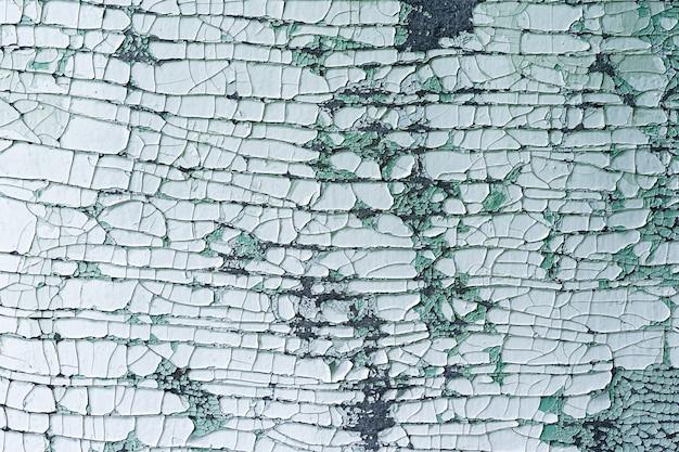 Textura de parede em flocos vintage antiga para a parede pintada de rachadura no fundo