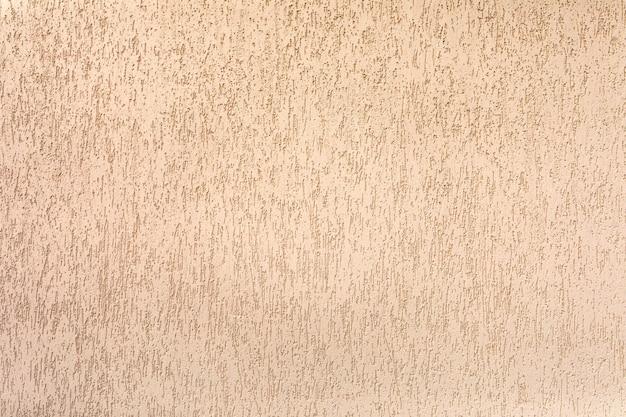 Textura de parede estucada. a cobertura decorativa de uma parede avançada é constante contra condições externas agressivas.
