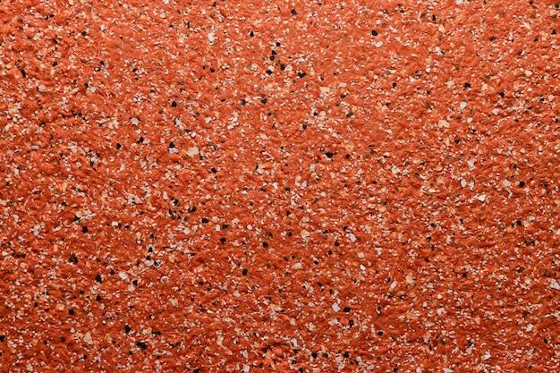 Textura de parede granulada na cor vermelha, fundo de superfície