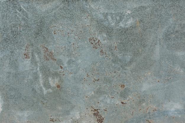 Textura de parede grunge enferrujada danificada de cor clara