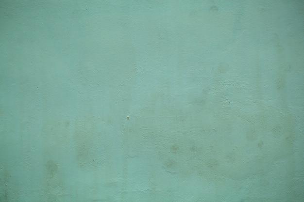 Textura de parede pintada de verde floresta maçante com um close-up na superfície em uma exibição de quadro completo.