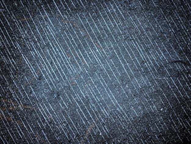 Textura de parede velha com cores decorativas de gesso azul marinho e preto.