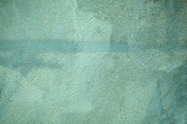 Textura de parede verde floresta desvanecimento estilo vintage com superfície áspera de cimento em uma exibição de quadro completo.