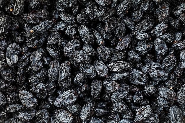 Textura de passa preta, frutos secos populares. uvas secas.